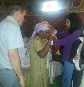 Sarita and Tony praying