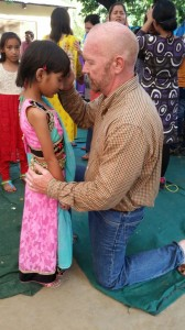Dan praying over small girl