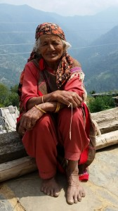 woman by road in kullu mtn village