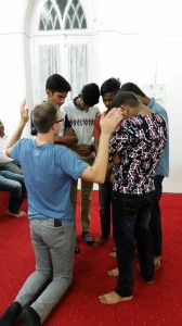sep16-jammu-andrew-praying-over-group-of-men